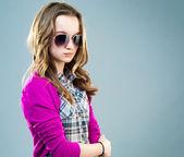 Little fashion model in sunglasses — Stock Photo