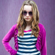 Little fashion model in sunglasses — Stock Photo