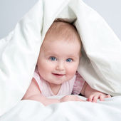Cute baby under a blanket — Stock Photo
