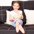 Little girl watching TV — Stock Photo