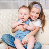 Girl and her little sister — Stock Photo