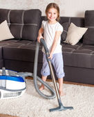 Little girl cleaning the room — Stock Photo