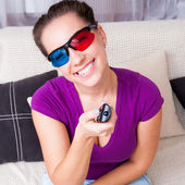 Young girl watching 3d television — Stock Photo