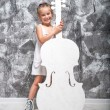 Little girl with her cello — Stock Photo