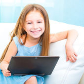 Little cute girl with a laptop — Stock Photo