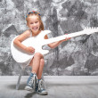 Stock Photo: Little girl with her guitar