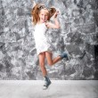 Stock Photo: Cute little girl jump
