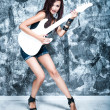 Beautiful rock singer with a guitar — Stock Photo