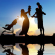 Happy parents with their little children — Stock Photo #27706043