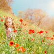 Cute little girl in a field — Stock Photo