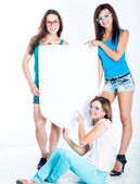 Girls holding a blank banner — Stock Photo