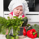 Little girl preparing a meal — Stock Photo