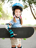 Cute little girl in a helmet — Stock Photo