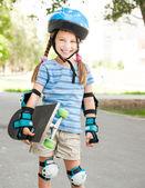 Cute little girl in a helmet — Stock Photo