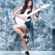 Beautiful rock singer with a guitar — Stock Photo #28436819