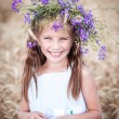 Beautiful little girl  in a field of wheat — Stock Photo