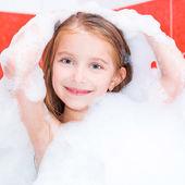 Small pretty girl is taking a bath — Stock Photo