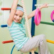 Happy little girl at home gym — Zdjęcie stockowe
