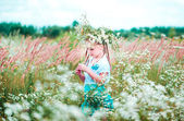 Little cute girl on the field — Stock Photo
