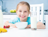 Little girl at the breakfast — Stock Photo
