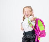 Cute little girl in school uniform — Stock Photo