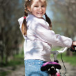 Little girl on her bike — Stock Photo #29528349