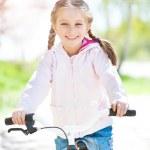 Little girl on her bike — Stock Photo #29528355