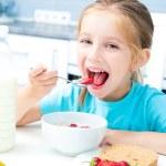 Little girl eating — Stock Photo #29528361