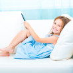 Little girl holding a e-book — Stock Photo #29528367