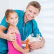 Doctor of veterenarii and little girl with rabbit — Stock Photo