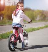 Little girl on her bike — Stock Photo