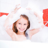 Smiling pretty girl is taking a bath — Stock Photo