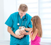 Doctor and little girl with a rabbit — Stock Photo