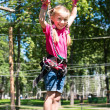 Stock Photo: Little girl in a rope park