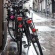 Two bicycles in the rain — Stock Photo
