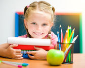 Little girl at workplace with the books — Stock Photo