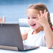 Little girl with her computer — Stock Photo #32207827