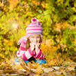 Autumn portrait of a little girl — Stock Photo #32209403