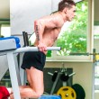 Athletically built sportsman in the gym — Foto de Stock
