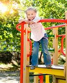 Little girl on outdoor playground — Stock Photo