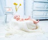 Beautiful baby in the bright interior — Stock Photo