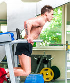 Athletically built sportsman in the gym — Stock Photo