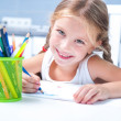 Little girl drawing with pencils — Stockfoto #32212471