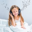 Little pretty girl listening to music — Stock Photo #32212637