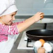 Little girl cracking egg — Stock Photo #33666439