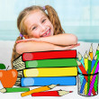 Little girl with the books — Stock Photo