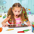 Little girl and her magic tablet — Stock Photo