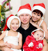 Family and a Christmas Tree — Stockfoto
