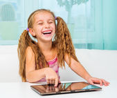 Cute little girl with a laptop — Stock Photo