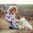 Stock Photo: Little girl with her dog